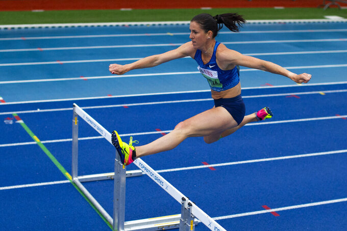 FILE - In this file photo dated Thursday, July 9, 2020, Zuzana Hejnova of the Czech Republic competes in the 300 meter hurdles women in the Weltklasse track meet in Papendal, outside Arnhem, Netherlands.  Two-time world champion in the women's 400 hurdles Zuzana Hejnova has pulled out of the upcoming Tokyo Olympics due to an Achilles tendon injury, she announced Thursday July 15, 2021. (AP Photo/Peter Dejong, FILE)