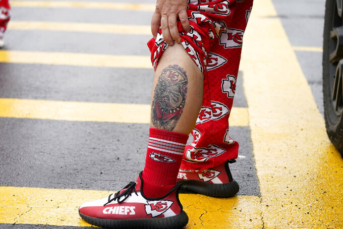 A Kansas City Chiefs fan shows off his tattoo before an NFL football game between the Chiefs and the Houston Texans Thursday, Sept. 10, 2020, in Kansas City, Mo. (AP Photo/Charlie Riedel)