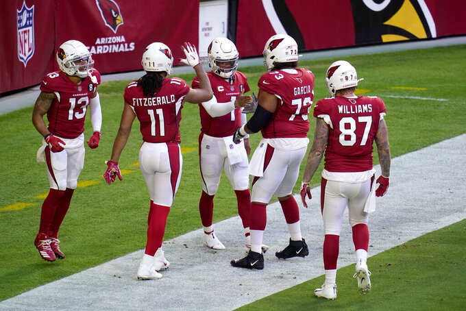 Arizona Cardinals quarterback Kyler Murray (1) celebrates his rushing touchdown with teammates during the first half of an NFL football game against the Philadelphia Eagles, Sunday, Dec. 20, 2020, in Glendale, Ariz. (AP Photo/Ross D. Franklin)