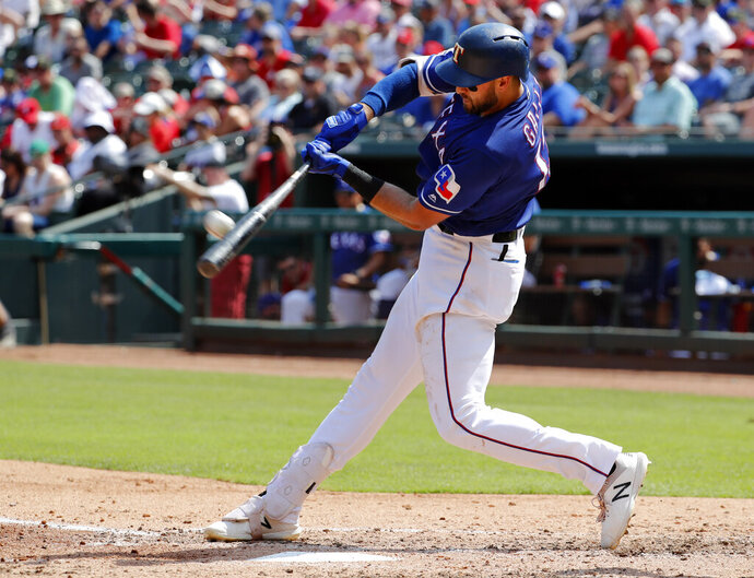 Texas Rangers' Joey Gallo connects for a two-run home run on a pitch from Kansas City Royals' Homer Bailey in the fourth inning of a baseball game in Arlington, Texas, Saturday, June 1, 2019. Hunter Pence scored on the shot by Gallo. (AP Photo/Tony Gutierrez)