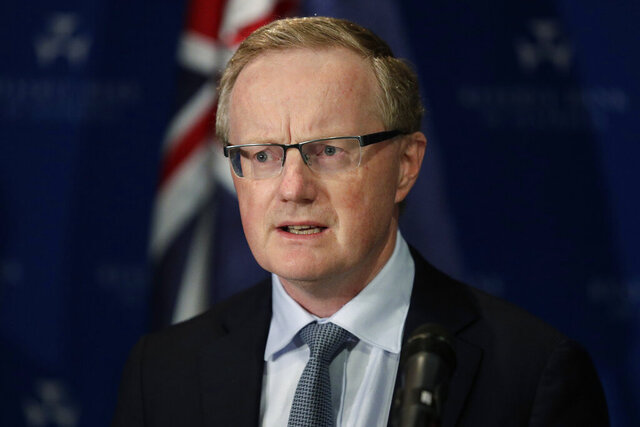 Reserve Bank Gov. Philip Lowe outlines measures the bank will take to support an economy rocked by international travel restrictions, bans on large public gatherings and escalating unemployment, in Sydney, Thursday, March 19, 2020. Australia's central bank cut its benchmark interest rate by a quarter of a percentage point to a record low 0.25%, urgently seeking to alleviate economic shocks from the new coronavirus. (AP Photo/Rick Rycroft)