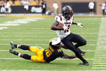 South Carolina wide receiver Shi Smith, right, avoids the tackle of Missouri's Joshuah Bledsoe during the third quarter of an NCAA college football game Saturday, Sept. 21, 2019, in Columbia, Mo. (AP Photo/L.G. Patterson)