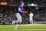 Toronto Blue Jays' Randal Grichuk reacts as he rounds first base after hitting a home run off New York Yankees pitcher Nestor Cortes Jr. during the fifth inning of a baseball game Thursday, Sept. 9, 2021, in New York. (AP Photo/Adam Hunger)