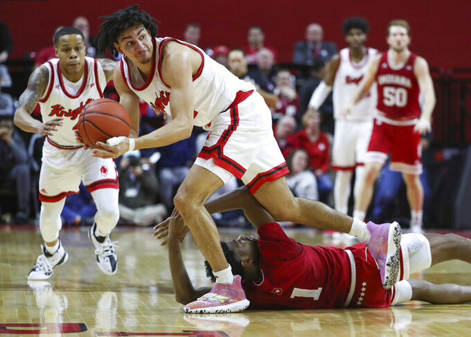 Rutgers guard Geo Baker (0) steals the ball from Indiana  guard Al Durham (1) during the first half of an NCAA college basketball game, Wednesday, Jan. 15, 2020 in Piscataway, N.J. (Andrew Mills/NJ Advance Media via AP)
