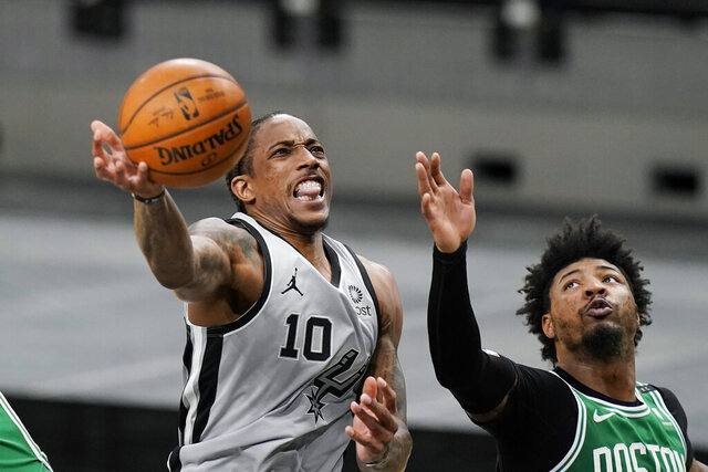San Antonio Spurs forward DeMar DeRozan (10) scores past Boston Celtics guard Marcus Smart (36) during the second half of an NBA basketball game in San Antonio, Wednesday, Jan. 27, 2021. (AP Photo/Eric Gay)