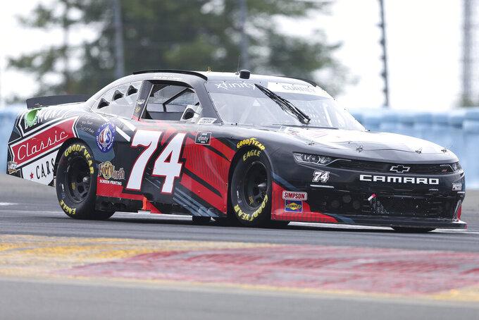 Bayley Currey drives between Turn 1 and the Esses in the NASCAR Xfinity Series auto race at Watkins Glen International in Watkins Glen, N.Y., on Saturday, Aug. 7, 2021. (AP Photo/Joshua Bessex)
