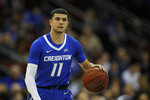 Creighton guard Marcus Zegarowski (11) looks to pass against Seton Hall during the first half of an NCAA college basketball game Wednesday, Feb. 12, 2020, in Newark, N.J.. (AP Photo/Adam Hunger)
