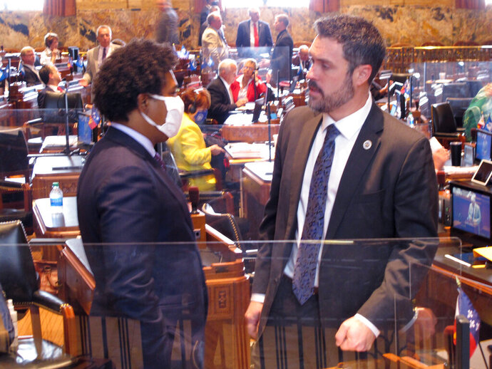 House Republican leader Blake Miguez, R-Erath, left, speaks with Rep. Gary Carter, D-New Orleans, on the House floor on the final day of the special session on Oct. 23, 2020, in Baton Rouge, La. (AP Photo/Melinda Deslatte)