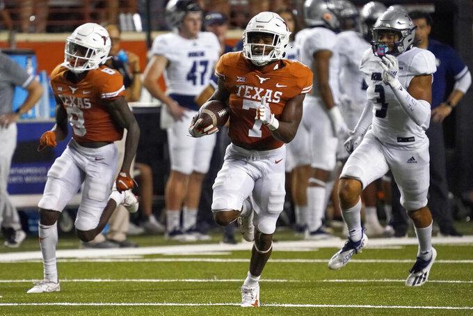 Texas running back Keilan Robinson (7) runs for a long touchdown against Rice during the second half of an NCAA college football game Saturday, Sept. 18, 2021, in Austin, Texas. (AP Photo/Chuck Burton)