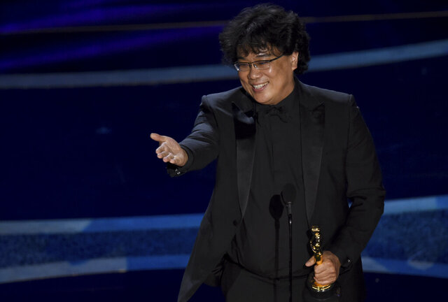 Bong Joon Ho accepts the award for best director for