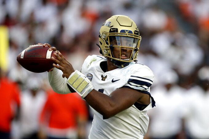 Akron quarterback Kato Nelson looks for a receiver during the first half of the team's NCAA college football game against Auburn on Saturday, Sept. 4, 2021, in Auburn, Ala. (AP Photo/Butch Dill)