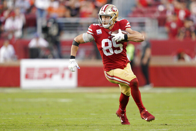 San Francisco 49ers tight end George Kittle (85) runs against the Cleveland Browns during the first half of an NFL football game in Santa Clara, Calif., Monday, Oct. 7, 2019. (AP Photo/Tony Avelar)