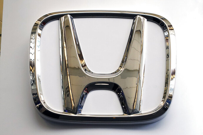 """FILE - This Thursday, Feb. 14, 2019 file photo shows the Honda logo on a 2019 Honda Civic on display at the 2019 Pittsburgh International Auto Show in Pittsburgh. Britain's Sky News says Honda is to close a car factory in western England with the potential loss of 3,500 jobs. The broadcaster says the Japanese carmaker will announce Tuesday, Feb. 19 that the Swindon plant, where Honda makes its Civic model, will close in 2022. Honda said Monday that it could not comment """"at this stage."""" (AP Photo/Gene J. Puskar, file)"""