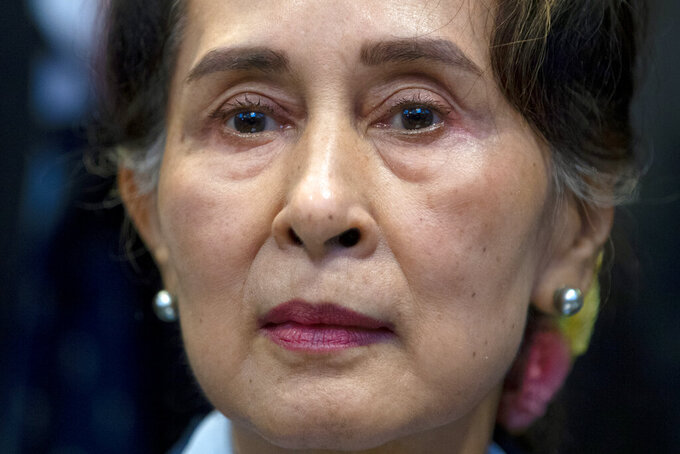 FILE - In this Dec. 11, 2019, file photo, Myanmar's leader Aung San Suu Kyi waits to address judges of the International Court of Justice on the second day of three days of hearings in The Hague, Netherlands. Myanmar's ousted leader Aung San Suu Kyi appeared in court in person Monday, May 24, 2021, for the first time since the military arrested her when it seized power on Feb. 1, Myanmar media reported.(AP Photo/Peter Dejong, File)