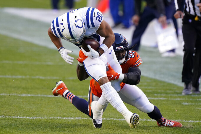 Indianapolis Colts' Jordan Wilkins (20) is tackled by Chicago Bears' Danny Trevathan (59) during the second half of an NFL football game, Sunday, Oct. 4, 2020, in Chicago. (AP Photo/Nam Y. Huh)