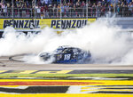 Kyle Busch celebrates with a burnout after winning the NASCAR Xfinity Series auto race Saturday, March 2, 2019, at Las Vegas Motor Speedway in Las Vegas. (Benjamin Hager/Las Vegas Review-Journal via AP)