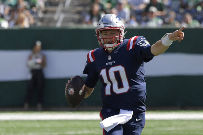 New England Patriots quarterback Mac Jones looks to throw during the first half of an NFL football game against the New York Jets, Sunday, Sept. 19, 2021, in East Rutherford, N.J. (AP Photo/Bill Kostroun)