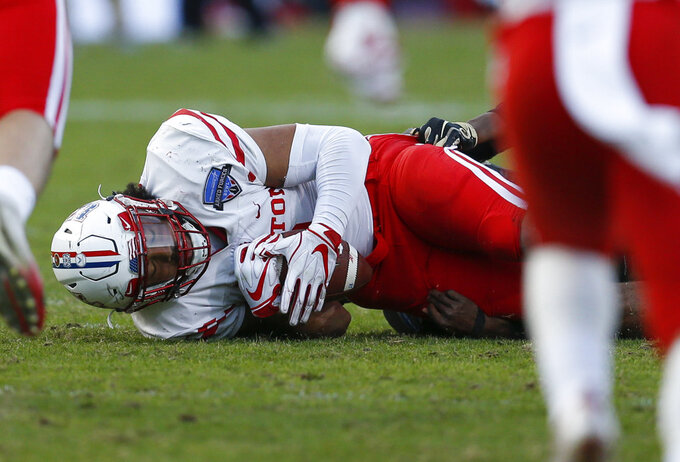 Houston linebacker Emeke Egbule (8) recovers a fumble by Army quarterback Cam Thomas during the second half of Armed Forces Bowl NCAA college football game Saturday, Dec. 22, 2018, in Fort Worth, Texas. Army won 70-14. (AP Photo/Jim Cowsert)