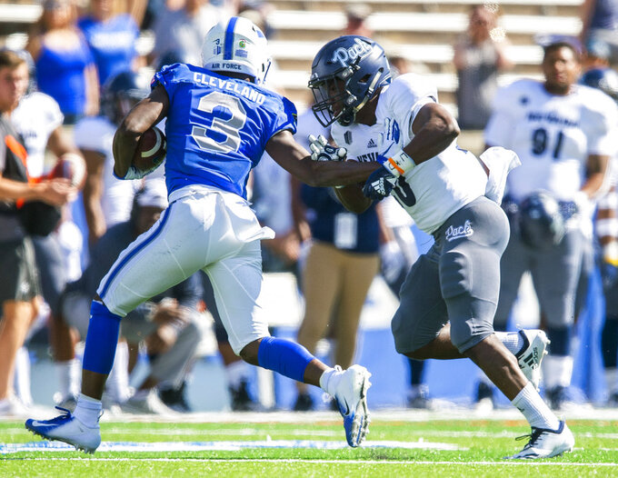 Air Force wide receiver Ronald Cleveland (3) pushes off Nevada defensive back Knowledge Smith (20) during the first half of an NCAA college football game, Saturday, Sept. 29, 2018 in Colorado Springs, Colo. (Dougal Brownlie/The Gazette via AP)