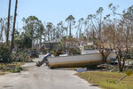 Destruction can be seen all over Mexico Beach Friday, Oct. 12, 2018. Residents of the small beach town of Mexico Beach, Fla., began to make their way back to their homes some for the first time after Hurricane Michael made landfall Wednesday. (Chris Urso/The Tampa Bay Times via AP)
