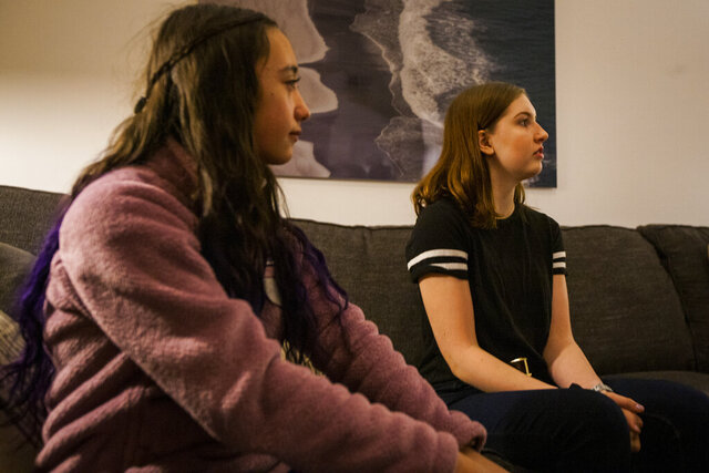 In this Jan. 10, 2020 photo, Brie Gesick, left, of Virginia Beach, and Jamie Van Cleave, of Yorktown ,both suffer from epilepsy say that living with condition is like being in prison in Yorktown, Va. Senate bill 420, a bill submitted by state Sen. Bill DeSteph, would help make life easier at school for them and other children that suffer from seizure related conditions. (John C. Clark/The Daily Press via AP)