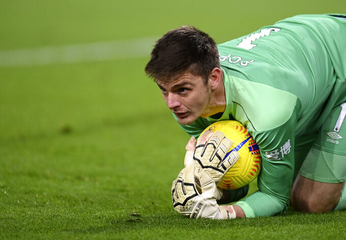 Burnley's goalkeeper Nick Pope makes a save during the English Premier League soccer match between Burnley and Crystal Palace at the Turf Moor stadium in Burnley, England, Monday, Nov. 23, 2020. (Michael Regan/Pool via AP)