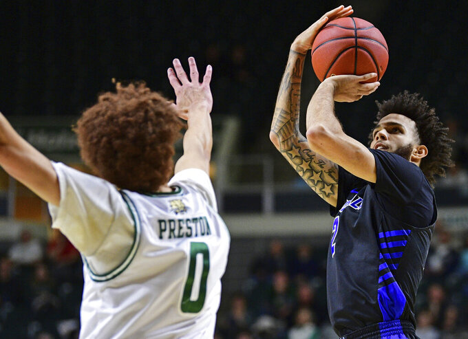 Buffalo guard Jayvon Graves shoots a 3-pointer against Ohio guard Jason Preston during the first half of an NCAA college basketball game Tuesday, March 5, 2019, in Athens, Ohio. (AP Photo/David Dermer)