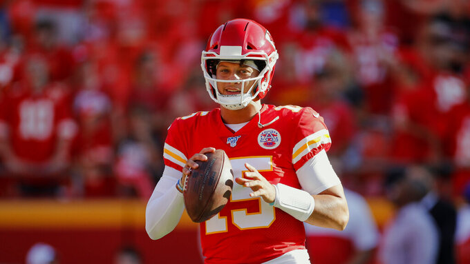 Kansas City Chiefs quarterback Patrick Mahomes (15) warms up before an NFL preseason football game against the Cincinnati Bengals in Kansas City, Mo., Saturday, Aug. 10, 2019. (AP Photo/Colin E. Braley)