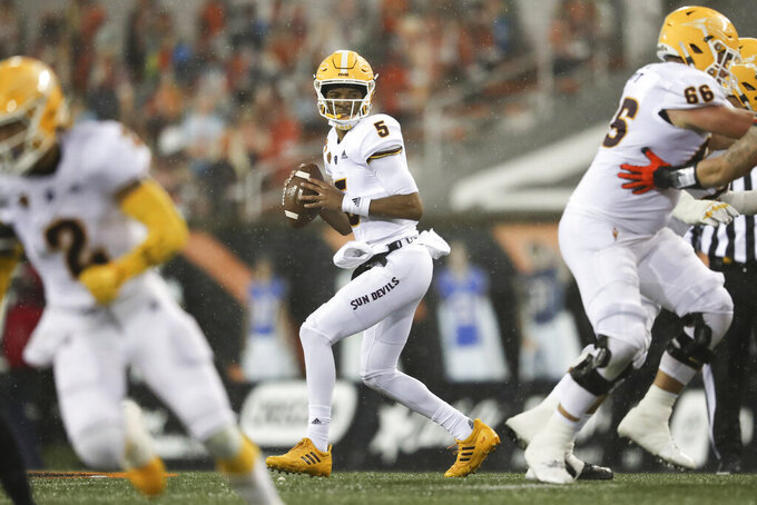 Arizona State quarterback Jayden Daniels (5) drops back to pass during the first half of an NCAA college football game against Oregon State in Corvallis, Ore., Saturday, Dec. 19, 2020. (AP Photo/Amanda Loman)