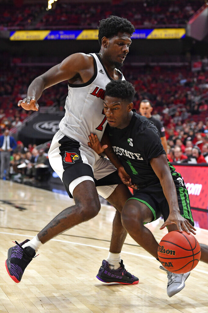 South Carolina Upstate guard Dalvin White (1) attempts to get through the defense of Louisville guard Darius Perry (2) during the first half of an NCAA college basketball game in Louisville, Ky., Wednesday, Nov. 20, 2019. (AP Photo/Timothy D. Easley)