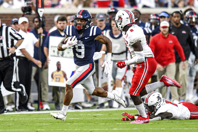 Mississippi running back Jerrion Ealy (9) runs against Austin Peay safety Kory Chapman (6) during an NCAA college football game in Oxford, Miss., Saturday, Sept. 11, 2021. (AP Photo/Bruce Newman)