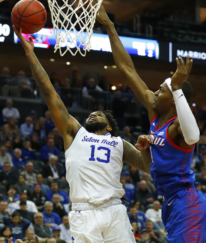 Seton Hall's Myles Powell (13) drives to the basket against DePaul's Paul Reed (4) during the second half of an NCAA college basketball game Wednesday, Jan. 29, 2020, in Newark, N.J. (AP Photo/Noah K. Murray)