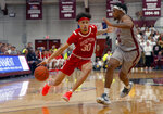 Boston University's  Javante McCoy (30) drives past Colgate's Nelly Cummings (0) during the first half of the NCAA Patriot League Conference college basketball championship at Cotterell Court, Wednesday, March 11, 2020, in Hamilton, N.Y. (AP Photo/John Munson)