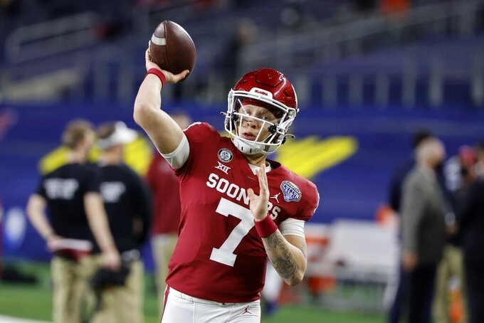 Oklahoma quarterback Spencer Rattler (7) warms up before the first half of the Cotton Bowl NCAA college football game against Florida in Arlington, Texas, Dec. 30, 2020. Before Oklahoma eventually jumps to the Southeastern Conference, the Sooners first will focus on trying to win their seventh-straight Big 12 title. Oklahoma and Texas have accepted invitations to join the SEC in 2025, adding two marquee names to the already dominant conference. Rattler leads a talented, experienced team that is ranked No. 2 in the preseason Top 25 -- Oklahoma's highest preseason ranking since 2011 and its best under coach Riley. (AP Photo/Michael Ainsworth)