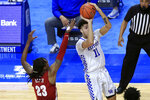 Kentucky's Dontaie Allen (11) shoots while defended by Alabama's John Petty Jr. during the second half of an NCAA college basketball game in Lexington, Ky., Tuesday, Jan. 12, 2021. (AP Photo/James Crisp)