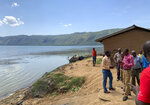 This photo taken Thursday, April 18, 2019 and released by the International Rescue Committee (IRC), shows the shores of Lake Albert near the border with Congo, at Kabakanga in Kagadi district, western Uganda. Uganda's health ministry said late Tuesday, June 11, 2019 that a child in Uganda has tested positive for Ebola in the first cross-border case of the deadly virus since an outbreak started in neighboring Congo last year. (Ben Wise/International Rescue Committee via AP)