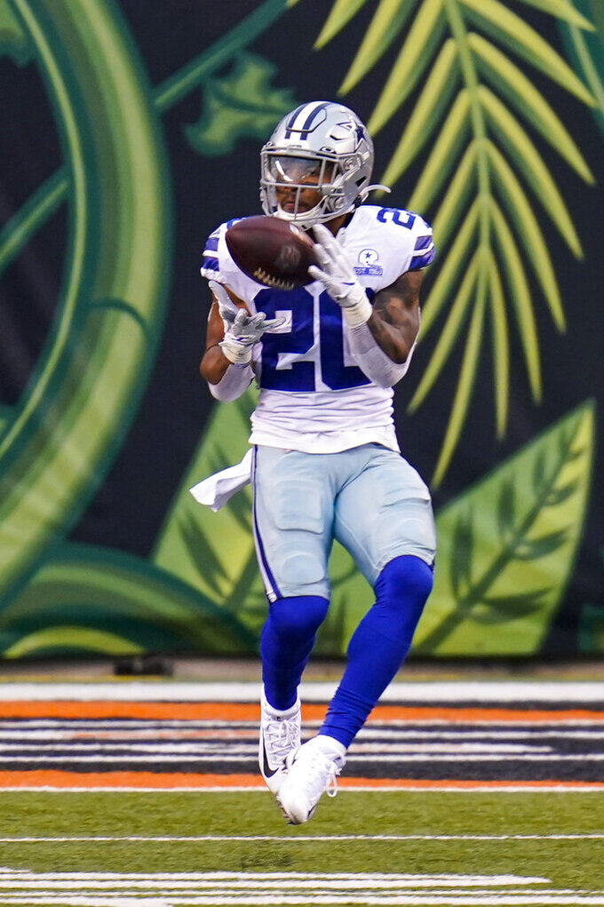 Dallas Cowboys running back Tony Pollard (20) makes a catch on his way to a touchdown against the Cincinnati Bengals in the second half of an NFL football game in Cincinnati, Sunday, Dec. 13, 2020. (AP Photo/Bryan Woolston)