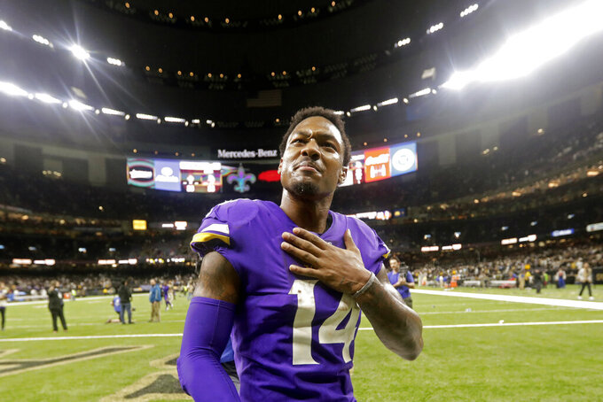 FILE - In this Jan. 5, 2020, file photo, Minnesota Vikings wide receiver Stefon Diggs (14) reacts in overtime of an NFL wild-card playoff football game against the New Orleans Saints in New Orleans. The Vikings won 26-20. Buffalo Bills general manager Brandon Beane made a bold move in the offseason by giving up four draft picks _ including the 22nd overall _ to acquire Stefon Diggs in a trade with the Minnesota Vikings. The Bills are left with seven picks over the final six rounds, starting with No. 54. (AP Photo/Brett Duke, File)