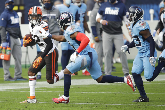 Cleveland Browns wide receiver Rashard Higgins (82) tries to get past Tennessee Titans free safety Kevin Byard (31) and cornerback Desmond King (33) in the first half of an NFL football game Sunday, Dec. 6, 2020, in Nashville, Tenn. (AP Photo/Ben Margot)