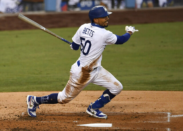 Mookie Betts (50) of the Los Angeles Dodgers singles against the Colorado Rockies in the fourth inning of a MLB baseball game at Dodger Stadium in Los Angeles on Saturday, Sept. 5, 2020. (Keith Birmingham/The Orange County Register via AP)