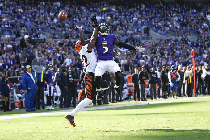 Baltimore Ravens wide receiver Marquise Brown (5) goes up to try to catch a pass as Cincinnati Bengals cornerback Chidobe Awuzie defends during the second half of an NFL football game, Sunday, Oct. 24, 2021, in Baltimore. (AP Photo/Nick Wass)