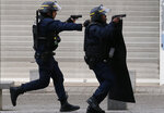 FILE - In this Nov. 18, 2015 file photo armed police operate in Saint-Denis, a northern suburb of Paris, Wednesday, Nov. 18, 2015. (AP Photo/Francois Mori)