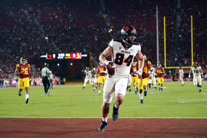 Oregon State tight end Teagan Quitoriano (84) runs in for a touchdown during the first half of an NCAA college football game against Southern California Saturday, Sept. 25, 2021, in Los Angeles. (AP Photo/Marcio Jose Sanchez)