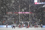 Washington quarterback Jake Browning (3) calls for the snap as snow falls at Martin Stadium during the second half of an NCAA college football game against Washington State, Friday, Nov. 23, 2018, in Pullman, Wash. (AP Photo/Ted S. Warren)