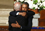 FILE - In this June 6, 2015, file photo, then=President Barack Obama hugs then-Vice President Joe Biden during funeral services for Biden's son, Beau Biden, at St. Anthony of Padua Church in Wilmington, Del. (Yuri Gripas/Pool Photo via AP, File)