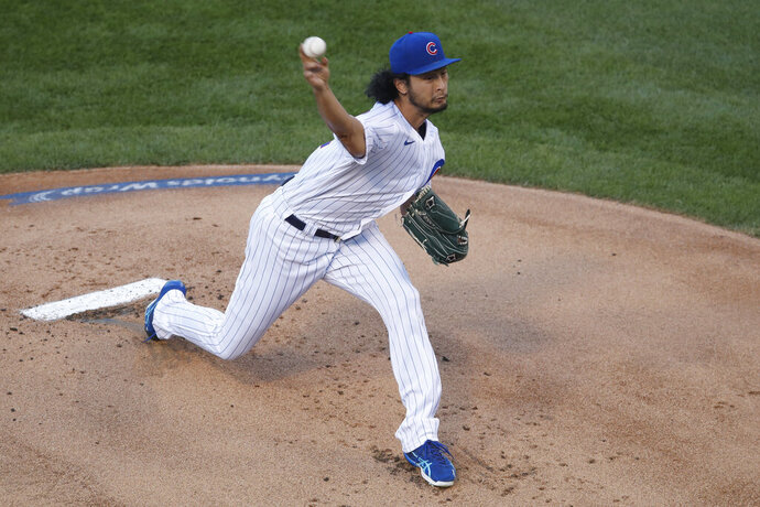 Chicago Cubs starting pitcher Yu Darvish delivers during the first inning of a baseball game against the Milwaukee Brewers, Thursday, Aug. 13, 2020, in Chicago. (AP Photo/Jeff Haynes)