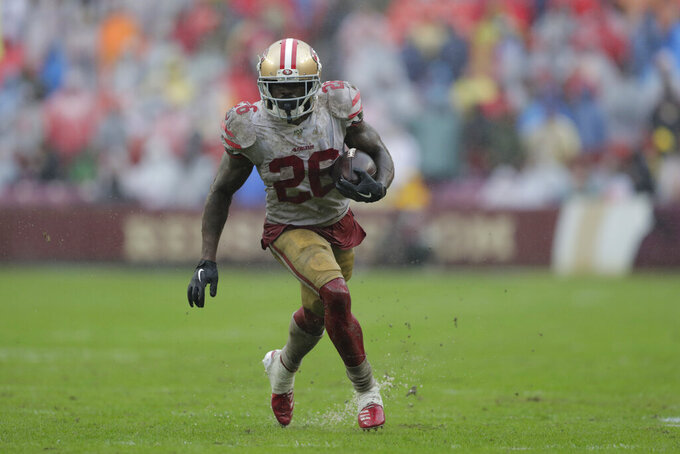 San Francisco 49ers running back Tevin Coleman rushes the ball in the second half of an NFL football game against the Washington Redskins, Sunday, Oct. 20, 2019, in Landover, Md. (AP Photo/Julio Cortez)