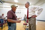 In this June 30, 2021, photo Sen. Chuck Grassley, R-Iowa, talks with Don Poggensee, of Ida Grove, Iowa, left, during a town hall meeting in Ida Grove, Iowa. (AP Photo/Charlie Neibergall)