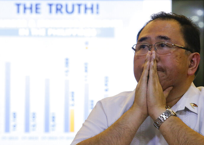 Undersecretary Severo Catura, executive director of the Presidential Human Rights Committee secretariat, gestures as he listens to questions from reporters during a news conference in metropolitan Manila, Philippines, Thursday, July 18, 2019. A Philippine official says thousands of police officers have received administrative punishments, and more than 2,000 were dismissed, for wrongdoings during raids where drug suspects were killed. (AP Photo/Aaron Favila)
