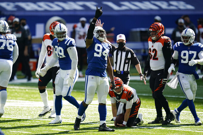 Indianapolis Colts defensive end Tyquan Lewis (94) reacts after a sack of Cincinnati Bengals quarterback Joe Burrow (9) during the first half of an NFL football game, Sunday, Oct. 18, 2020, in Indianapolis. (AP Photo/Michael Conroy)